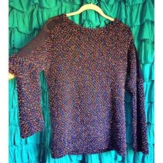 Black Multi-Color/Sheer Sweater Top NWOT - Stylish and comfortable long sweater shirt with sheer shoulder/upper sleeves. Goes well with leggings or even as a dress depending on height. I'm 5'6 and it's short for me to get away with it as a dress. Perfect for the wintertime (especially the holidays)! Never worn. Urban Outfitters Sweaters