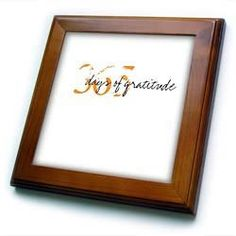 """365 Gratitude - 8x8 Framed Tile by Patricia Sanders. $22.99. Inset high gloss 6"""" x 6"""" ceramic tile.. Dimensions: 8"""" H x 8"""" W x 1/2"""" D. Solid wood frame. Cherry Finish. Keyhole in the back of frame allows for easy hanging.. 365 Gratitude Framed Tile is 8"""" x 8"""" with a 6"""" x 6"""" high gloss inset ceramic tile, surrounded by a solid wood frame with predrilled keyhole for easy wall mounting."""