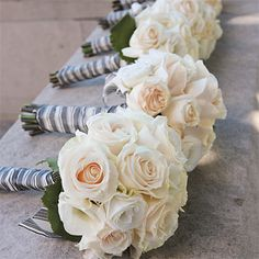 Blush and ivory roses with champagne wrap. Randon, what do you think for the maids? I love these! I don't like the wrap but the flowers are beautiful.