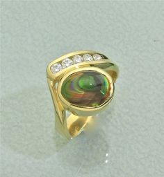 Glenn Dizon Designs.  18K gold fire agate and diamond ring.  Just finished and available.