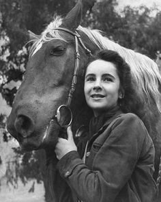 1945  She posed with a saddle horse in an homage to her career-making role.