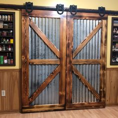 Upcycled Pine from old table with new variegated steel. Applied chemicals to age the steel. My dream pantry doors! Barn Door Designs, Rustic House, Decor, Barn, Rustic Bathrooms, Door Design, Hanging Barn Doors, Metal Wall Clock, Doors