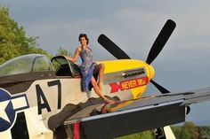 1940's Style Pin-Up Girl Standing Barefoot on the Wing of a P-51 Mustang Photographic Print