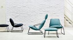 Display of VILLSTAD easy chairs, armchairs and footstools in anthracite and turquoise