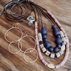 Vacation essentials; African trade bead and gold bead necklaces, double hoop earrings and the super sparkly double diamond slice ring!