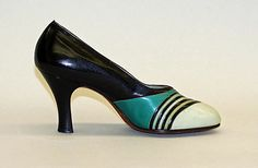 Pumps Morris Wolock & Co. Date: 1926–32 Culture: American Medium: leather Dimensions: Length: 9 1/2 in. (24.1 cm) Credit Line: Gift of The Guild of Better Shoe Manufacturers, Inc., 1948