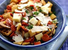 Shaved Parmesan, cubes of mozzarella and mini-pepperonis upgrade your classic Chex Mix to new, pizza-flavored heights. One of Betty's most popular Chex Mix recipes! Pro tip: This one's best served immediately, so the moisture in the mozzarella won't make it soggy.