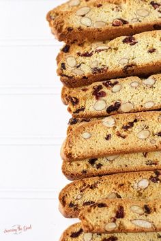 Cranberry, almond biscotti is perfect for enjoying alongside a cup of espresso or coffee drink. This easy Italian twice baked cookie is delicious to enjoy at home or package them up and give as a gift.