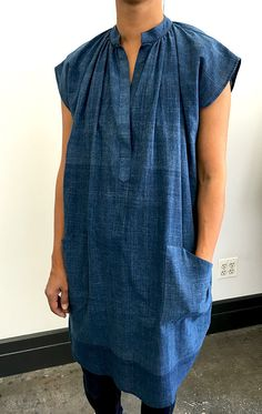 handloomed khadi cotton tunic in Indigo with pockets. This khadi indigo fabric has weaving line inconsistencies which make it even more special and handmade. Color may vary from mid blue to a darker b