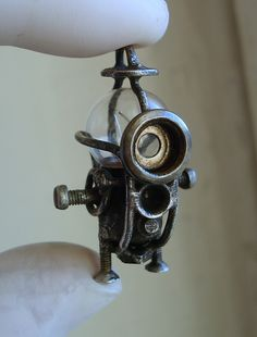 itty bitty steampunk diver--- if you look close... looks like a mini minion!
