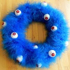 Google Image Result for http://static.tipjunkie.com/subsite-content/halloween-thumbs/monster-halloween-wreath-how-to-make-halloween-decorations.JPG