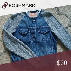 048cd753930 Shop Women s Levi s size S Jean Jackets at a discounted price at Poshmark.  Description  Levi s denim jacket with sweater material arms.