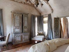 a parquet de Versailles floor, Nancy Corzine Satin (in Steel) curtains, an 18th-century Buffet de Corps armoire, and a Louis XVI chaise.
