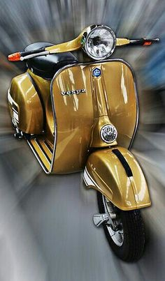Gold Vespa, of course it's gold. TG