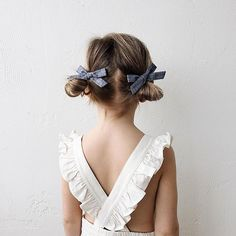 """Let's go on an adventure."" Two classic blue chambray schoolgirl bows to accompany your free spirit on her next adventure. This pigtail set features two petit schoolgirl bows that are each 1½ x 3½ inc"