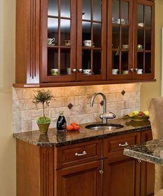 Kitchen Backsplash And Countertop Ideas grey granite countertops with cinnamon cherry cabinets | tan brown