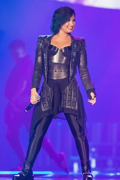 Demi Lovato is confidently fierce with her new blue hair during a performance on Oct. 2, 2014 at XFINITY Arena at Everett in Everett, Wash.