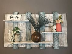 White and blue shelf that measures approximately 40 wide by approximately 24 tall. Shelf will be great in any room or any beach themed room.