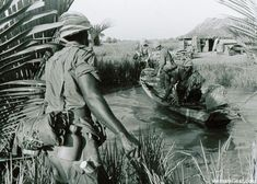 9th Infantry Division soldiers use a local sampan to cross a river near Long An in the Mekong Delta. October, 1967. ~ Vietnam War