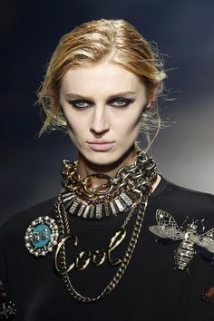 Statement necklacea and huge bee brooch. Lanvin