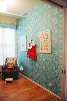 silk Uzbek Ikat fabric hung as wallpaper. WOW. Frame lengths of this like the framed wallpaper.