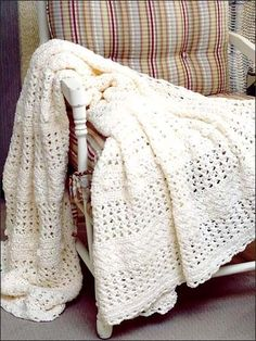 Summer Lace Afghan - Crocheted with sport weight yarn, this lightweight afghan is perfect for those cool spring and summer nights. Skill Level: Intermediate Designed by Joyce Nordstrom free pdf from FreePatterns.com