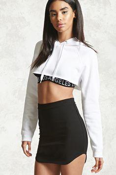 A knit mini skirt featuring a curved dolphin hem and an elasticized waistband.