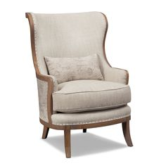 French Connection. Discover the place where French country charm meets modern living with the Madeline collection. This accent chair with hand-carved details serves as a rich and welcoming piece for your living room. Nailhead trim on the edge of the linen fabric is casual yet luxurious at the same time, while a modern accent pillow adds visual texture and instant flair. Features such as exposed wood and welted trim on the cushion display chic elegance. Flared wooden feet with a stunning…