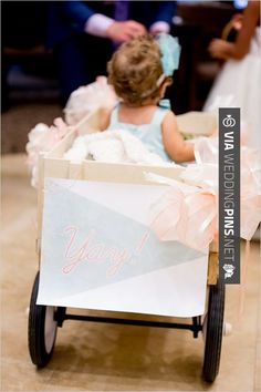 Amazing! - flower girl in a wagon…for the little ones you want in the wedding but don't quite know how they will cooperate! | CHECK OUT MORE GREAT FLOWER GIRL AND RING BEARER PHOTOS AND IDEAS AT WEDDINGPINS.NET | #weddings #wedding #flowergirl #flowergirls #rings #weddingring #ringbearer #ringbearers #weddingphotographer #bachelorparty #events #forweddings #fairytalewedding #fairytaleweddings #romance