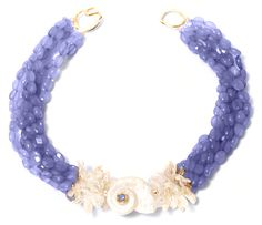 Helga Wagner Faceted lavender beads with stick fresh water pearls with white Turbo Shell, Blue topaz cabochon set in 14k gold with tiffany clasp.