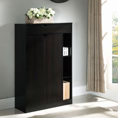 Tuck your heels, sandals, sneakers, dress shoes and more within this spacious storage piece. The Edmund Shoe Cabinet offers eight variously sized shelves to accommodate all your footwear and accessories, making it a must-have.