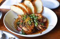 Boxing Room's take on New Orleans barbecue shrimp with bread and sauce