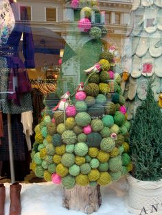 Yes, that's a Christmas tree-- covered in yarn balls and little birdies.  Apparently this was an Anthropologie window display last year.  Love | http://bannerandgarland.blogspot.com