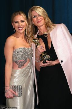 Good time: She posed for photos with her Marriage Story co-star Scarlett, who had also swa...