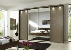 The Most Popular Choices for Wardrobe with Sliding Doors Black Rug For Contemporary Bedroom Plan With Modern Wardrobe Design Using Mirrored Sliding Doors And Stylish Track Lighting Wardrobe Furniture, Wardrobe Design Bedroom, Mirrored Wardrobe, Bedroom Furniture Design, Bedroom Wardrobe, Sliding Door Wardrobe Designs, Closet Designs, Contemporary Bedroom, Modern Bedroom