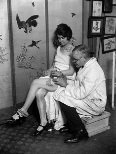17 Kick-Ass Vintage Photos Of Women With Tattoos / Like the flower on her shoulder