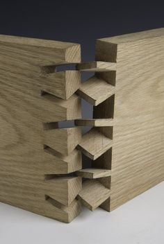 Twisted Dovetails. Seems digitally made to me. Straight dovetails made by hand are difficult enough...