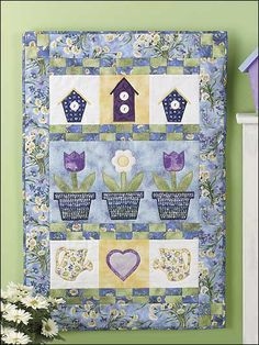 """""""Upsy Daisy"""" Garden Quilt free sewing pattern.  The birdhouses would make great curtains for my downstairs bathroom."""