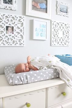 "baby boy nursery- ""I am a child of God""....love the frames and gray polka dot changing cover"
