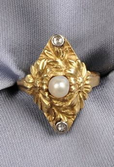 Art Nouveau 18kt Gold, Pearl, and Diamond Ring, the floral mount set with a pearl measuring approx. 4.00 mm, single-cut diamond melee accents
