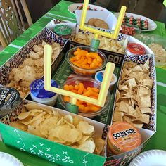 Super easy football party snacks! All of the ideas are really easy, quick to make, and adorable (like this stadium snack display)! No need to simply open a bag of chips and dump dip in a bowl when you can make an easy, football-themed treat in minutes. Click or visit FabEveryday.com for all the ideas, and make sure to pin these ones for your Super Bowl party, game watching party, or even a football-themed birthday party! #fabeveryday #football #superbowl #food
