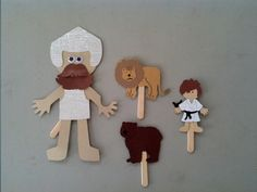 "David, Goliath, bear and lion paper puppets. We made these four our craft when doing our study about David.  I used the Cricut cartridges ""Paper Doll"" and ""Animal Kingdom"
