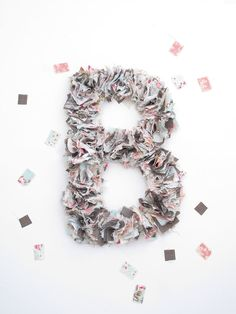 A surefire way to infuse a little more of 'you' into your wedding? Roll up your sleeves and put on your DIY hat. In fact, we have a whole section dedicated to DIY projects we love, and today, we're adding this super fun fabric scrap letter to the list. Keep reading for the how-to from...