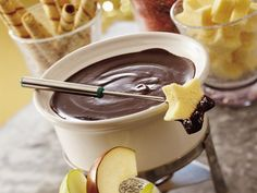 Dark Chocolate Raspberry Fondue - only 4 ingredients: whipping cream, seedless raspberry preserves, honey and semisweet chocolate chunks. Betty Crocker recipe.
