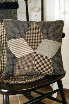 This Farmhouse Star quilted pillow features popular primitive colors of black and tan and coordinates with bedding from Primitive Star Quilt Shop.
