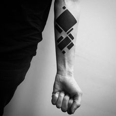 blackwork tattoo on forearm geometry