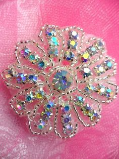 Aurora Borealis Crystal AB Rhinestone Floral Flower Beaded Applique  Measures: 2\   All measurements are approximate.  Application: Sew, glue or iron on.  Silver beads with Crystal AB Rhinestones.