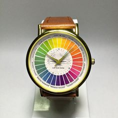 Color Wheel Watch. Vintage Style Watch. Mens Watch. Watches for Women. Wrist Watch. Jewelry. Print. Leather. Gift for Her. Leather Watch Freeforme Watches 2017 I also do custom or personalized watches , please contact me and Id be glad to make something special for you and your loved ones. *Dial design and photos are owned by Freeforme Ships Worldwide Type: Quartz Wrist Size: Adjustable from 17 cm to 21 cm (6.69 inches to 8.26 inches) Display: Analog Dial Window Material: Glass Case…