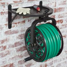 When not in use, keep your garden hose neatly stored out of the way with the Liberty Garden Navigator Rotating Hose Reel . Hose Storage, Garden Tool Storage, Garden Tools, Water Storage, Water Hose Holder, Garden Hose Holder, Hose Reel, Lawn Care, Water Garden