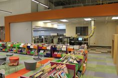 Picture books in the children's section and a view of the materials handling system, a high tech conveyor belt that transfers your returned items from the drive up book drop on the north side of the building to the circulation workroom, where staff cart and re-shelve the items.